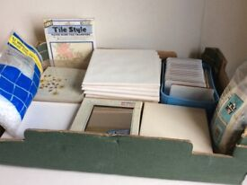 Box of assorted tiles including mirror tiles.