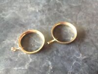 Brass curtain rings in bags of 50.