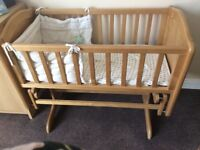 Wooden swinging crib
