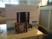 Unwanted gift Sony PlayStation 3 still in original box including controls and grand theft auto game