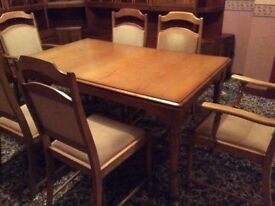 Dining Room Table extends to 8', 6 Chairs(2 with arms) Table as new.