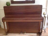 Art Deco piano - good tone, attractive, warm mahogany with clean lines.