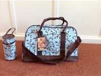 Brand new Ohbaby changing bag with accessories