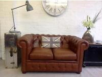 2 seater saddle tan leather Chesterfield sofa. Can deliver