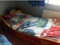 Red race car single bed, mattress/bedding not included, free- collection asap