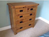 Chest of drawers. Solid oak 5 drawer with iron handles.