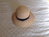 Marks and Spencers ladies straw hat with navy fabric trim worn but is in excellent condition