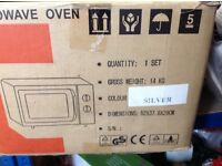 Silver grey microwave oven