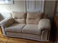 Three seater cream cloth covered sofa bed