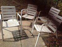 4x White plastic coated metal chairs