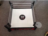 WWE wrestling ring with genuine figures