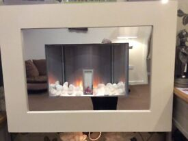 Wall mounted electric fire for sale.As new, only ever used background lights. Fire unused
