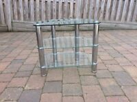 GLASS TV CORNER STAND WITH SILVER LEGS