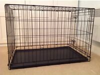 Metal dog crate and water bowl