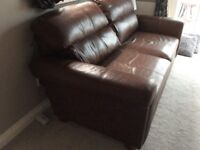 Next leather brown sofa. Four large cushions. 6foot. In good condition. Buyer must collect.