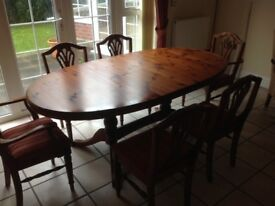 Pine extending dining room table and six chairs, armchair and pine wardrobe.