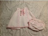 Pretty Originals white Spanish look dress with pink bow detail & matching knickers to fit 9-12