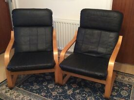 One chair taken now, still one left - wood frames with leather effect cushions.