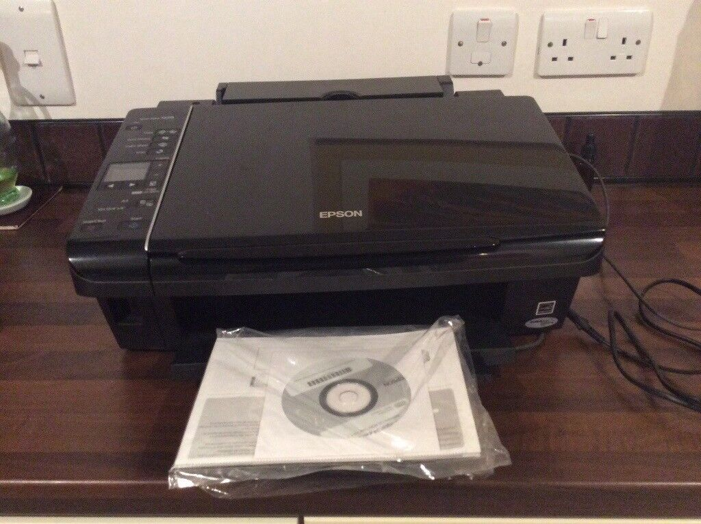 Printer Scanner- Epsom Stylus SX215, nearly new. In black, many features