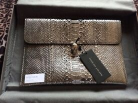 Auth Alexander McQueen phyton skin envelope clutch with silver crystal skull (brand new with tag)