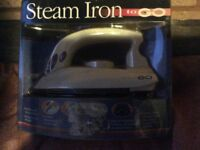 Brand new unopened Travel steam iron dual voltage 120v and 240v ideal for caravan and camping