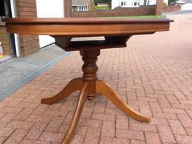 Extending dining table and 6 chairs ,2 are carvers