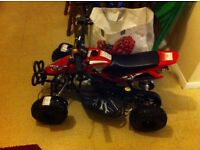 Childs (12+) red 50cc quad bike (petrol). Unwanted gift, never been used or had petrol in tank.