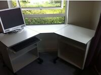 Solid corner desk on castors