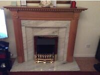 Oak fire place with electric fire and marble hearth