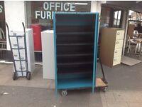 Blue steel framed storage cupboard.