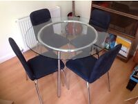 Ikea Salmi Glass Dining table and x4 Ikea Sixten padded chairs
