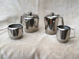 Stainless steel teapot, hot water jug, milk jug and sugar bowl