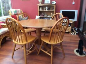 Pine coloured table and four chairs