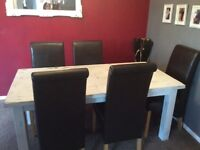 Distressed white table and 5 brown chairs