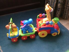 Musical animal train pulls carriage with 3 animals.