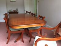 Reproduction yew dining table and six chairs very good condition extendable to seat eight.