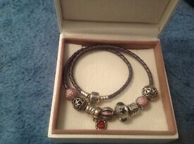 Pandora bracelet with 7charms and 2stoppers