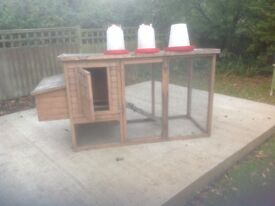 Chicken coop and assorted feeders