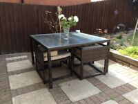 Lovely rattan style dining table and four chairs. Great for entertaining.