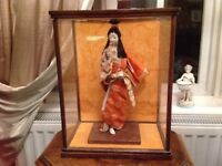 Antique porcelain geisha girl in wood/glass case