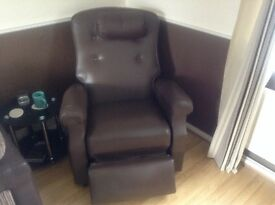 Adjustamatic brown leather massaging chair with remote control
