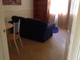 Self contained 1 bedroomed flat/granny annex with own front door, alarm and small side garden