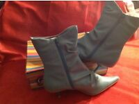 Brand new Aqua boots