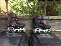 Girls rollerblades in black and purple, size 4-7