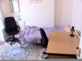 Room for rent in a clean house in Moss side area