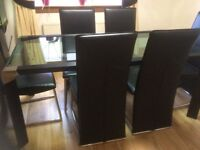 Modern glass dining table and 6 chairs - reduced £80 for quick sale