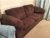 Matching brown cord sofa bed and armchair