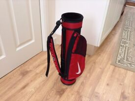 Childs Nike golf bag, red and black, lots of pockets, 56cms high, very good condition.