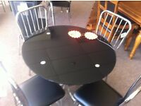 Excellent condition as new!!! Round black glass table and 4 metal/ leather chairs