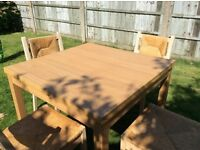 Extending dining table & six chairs, beech effect, good condition.